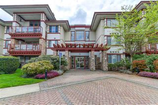 Photo 1: 207 16469 64 Avenue in Surrey: Cloverdale BC Condo for sale (Cloverdale)  : MLS®# R2326727