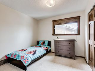 Photo 32: 227 COACH SIDE Road SW in Calgary: Coach Hill Detached for sale : MLS®# A1043295