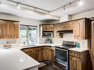 Photo 10: 227 COACH SIDE Road SW in Calgary: Coach Hill Detached for sale : MLS®# A1043295