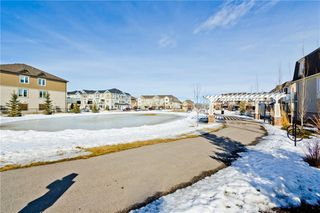 Photo 26: 117 Windstone Park SW: Airdrie Row/Townhouse for sale : MLS®# A1057841