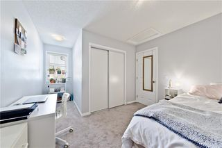 Photo 18: 117 Windstone Park SW: Airdrie Row/Townhouse for sale : MLS®# A1057841