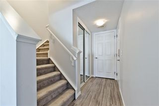 Photo 22: 117 Windstone Park SW: Airdrie Row/Townhouse for sale : MLS®# A1057841