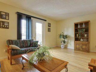 Photo 7: 333 Georgian Villas NE in Calgary: Marlborough Park House for sale : MLS®# C3468386