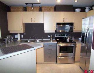 Photo 4: 404 10866 City Parkway in Surrey: Whalley Condo for sale (North Surrey)  : MLS®# F2908360