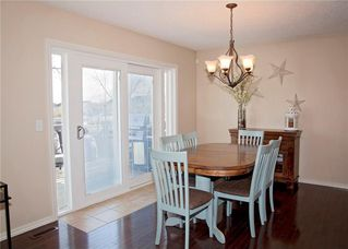 Photo 10: 214 CRYSTAL GREEN Place: Okotoks House for sale : MLS®# C4115773