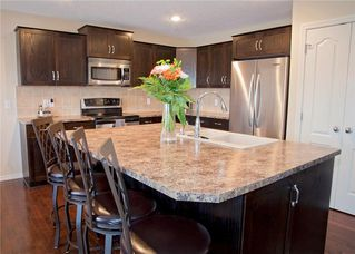 Photo 4: 214 CRYSTAL GREEN Place: Okotoks House for sale : MLS®# C4115773