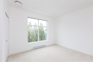 """Photo 12: 101 17568 57A Avenue in Surrey: Cloverdale BC Townhouse for sale in """"Hawthorne"""" (Cloverdale)  : MLS®# R2324757"""