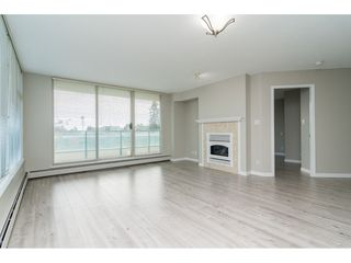 "Photo 4: 203 15466 NORTH BLUFF Road: White Rock Condo for sale in ""THE SUMMIT"" (South Surrey White Rock)  : MLS®# R2371084"