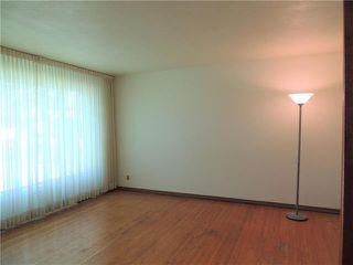 Photo 2: 229 Burrin Avenue in Winnipeg: West Kildonan Residential for sale (4D)  : MLS®# 1916693