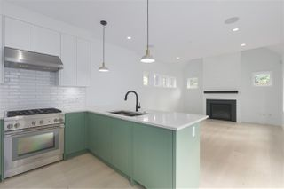 Photo 4: 2049 W 15TH Avenue in Vancouver: Kitsilano House 1/2 Duplex for sale (Vancouver West)  : MLS®# R2404140