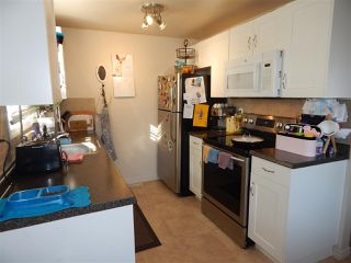 Photo 2: 12A CLAREVIEW Village in Edmonton: Zone 35 Townhouse for sale : MLS®# E4193872
