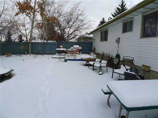 Photo 4: 192 BROOKGREEN Drive SW in Calgary: Braeside_Braesde Est Residential Detached Single Family for sale : MLS®# C3648966