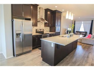 Photo 6: 87 EVANSBOROUGH Crescent NW in Calgary: Evanston House for sale : MLS®# C4048646