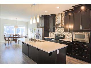 Photo 7: 87 EVANSBOROUGH Crescent NW in Calgary: Evanston House for sale : MLS®# C4048646