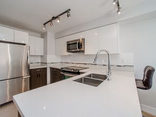 "Photo 3: 401 2408 E BROADWAY in Vancouver: Renfrew VE Condo for sale in ""BROADWAY CROSSING"" (Vancouver East)  : MLS®# R2102626"