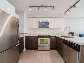 "Photo 2: 401 2408 E BROADWAY in Vancouver: Renfrew VE Condo for sale in ""BROADWAY CROSSING"" (Vancouver East)  : MLS®# R2102626"