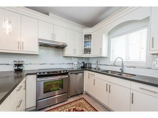 """Photo 4: 208 3488 SEFTON Street in Port Coquitlam: Glenwood PQ Townhouse for sale in """"SEFTON SPRINGS"""" : MLS®# R2165688"""