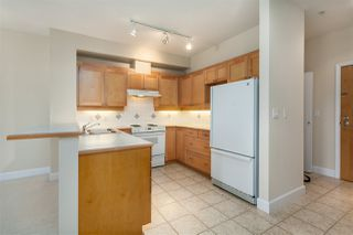 """Photo 3: 211 6198 ASH Street in Vancouver: Oakridge VW Condo for sale in """"THE GROVE"""" (Vancouver West)  : MLS®# R2193582"""