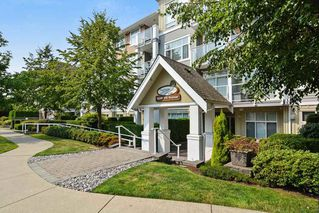 "Photo 2: 107 15299 17A Avenue in Surrey: King George Corridor Condo for sale in ""Flagstone Walk"" (South Surrey White Rock)  : MLS®# R2203688"