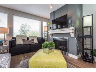 "Photo 3: 111 3099 TERRAVISTA Place in Port Moody: Port Moody Centre Condo for sale in ""GLENMORE"" : MLS®# R2272811"