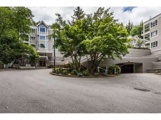 "Photo 2: 111 3099 TERRAVISTA Place in Port Moody: Port Moody Centre Condo for sale in ""GLENMORE"" : MLS®# R2272811"