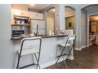 "Photo 8: 111 3099 TERRAVISTA Place in Port Moody: Port Moody Centre Condo for sale in ""GLENMORE"" : MLS®# R2272811"