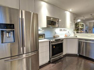 """Photo 2: 7490 HAWTHORNE Terrace in Burnaby: Highgate Townhouse for sale in """"Rockhill"""" (Burnaby South)  : MLS®# R2341008"""