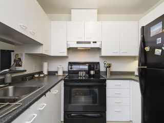 "Photo 14: 203 2355 W BROADWAY in Vancouver: Kitsilano Condo for sale in ""CONNAUGHT PARK PLACE"" (Vancouver West)  : MLS®# R2361595"