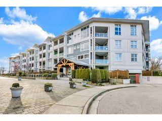 "Photo 1: 118 4500 WESTWATER Drive in Richmond: Steveston South Condo for sale in ""COPPER SKY WEST"" : MLS®# R2434248"