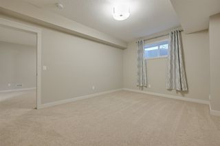 Photo 29: 6 7115 Armour Link in Edmonton: Zone 56 House Half Duplex for sale : MLS®# E4219991