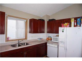 Photo 7: 7167 LAGUNA Way NE in Calgary: Monterey Park Residential Detached Single Family for sale : MLS®# C3652715