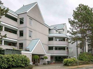 "Photo 1: 105 1365 W 4TH Avenue in Vancouver: False Creek Condo for sale in ""Granville Island Village"" (Vancouver West)  : MLS®# R2238704"