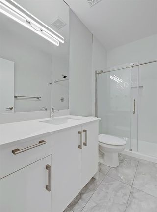 Photo 19: 115 408 27 Avenue NE in Calgary: Winston Heights/Mountview Row/Townhouse for sale : MLS®# A1054803