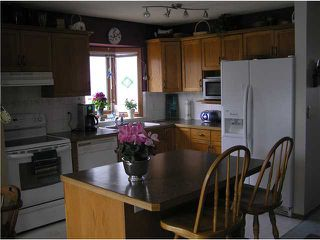 Photo 10: 4 8 RIVERVIEW Circle: Cochrane Residential Attached for sale : MLS®# C3472564