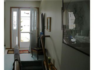 Photo 3: 4 8 RIVERVIEW Circle: Cochrane Residential Attached for sale : MLS®# C3472564