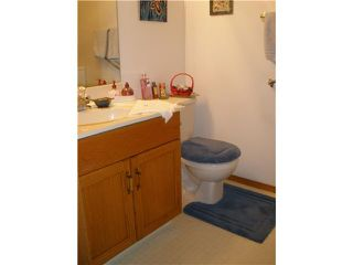 Photo 15: 4 8 RIVERVIEW Circle: Cochrane Residential Attached for sale : MLS®# C3472564
