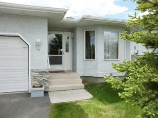 Photo 2: 4 8 RIVERVIEW Circle: Cochrane Residential Attached for sale : MLS®# C3472564