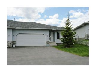 Photo 1: 4 8 RIVERVIEW Circle: Cochrane Residential Attached for sale : MLS®# C3472564