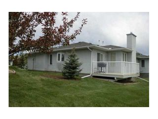 Photo 18: 4 8 RIVERVIEW Circle: Cochrane Residential Attached for sale : MLS®# C3472564