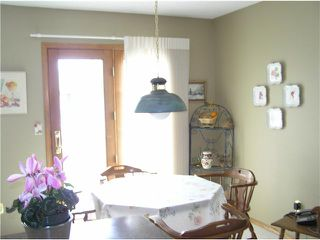 Photo 12: 4 8 RIVERVIEW Circle: Cochrane Residential Attached for sale : MLS®# C3472564