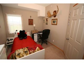 Photo 14: 314 72 QUIGLEY Drive: Cochrane Condo for sale : MLS®# C3477062