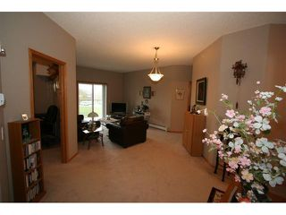 Photo 4: 314 72 QUIGLEY Drive: Cochrane Condo for sale : MLS®# C3477062