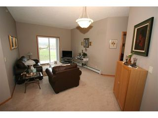 Photo 5: 314 72 QUIGLEY Drive: Cochrane Condo for sale : MLS®# C3477062