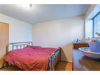 "Photo 14: 3128 E 1ST Avenue in Vancouver: Renfrew VE House for sale in ""RENFREW"" (Vancouver East)  : MLS®# V1108136"