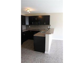 Photo 10: 11 TUCKER Circle: Okotoks House for sale : MLS®# C4073081