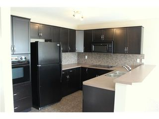 Photo 8: 11 TUCKER Circle: Okotoks House for sale : MLS®# C4073081