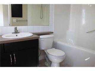 Photo 15: 11 TUCKER Circle: Okotoks House for sale : MLS®# C4073081