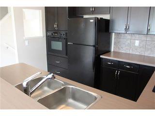Photo 9: 11 TUCKER Circle: Okotoks House for sale : MLS®# C4073081