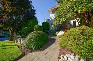 "Photo 1: 104 1225 MERKLIN Street: White Rock Townhouse for sale in ""Englesea Manor II"" (South Surrey White Rock)  : MLS®# R2212484"