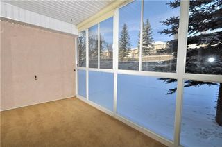 Photo 8: 113 6868 SIERRA MORENA Boulevard SW in Calgary: Signal Hill Condo for sale : MLS®# C4143308